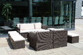 Patio seating made from resin wicker with white cushions Stock Photo