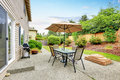 Patio table set with umbrella in the back yard. Royalty Free Stock Photo