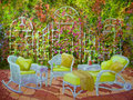 Patio with wicker furniture and trellis an inviting grouping of white is on a a white in a acrylic painting Royalty Free Stock Images