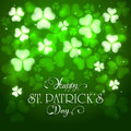 Patrick day green background with clovers and holiday lettering