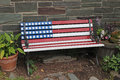 Patriotic bench an outdoor painted in the colors of the american flag Royalty Free Stock Image