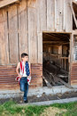 Patriotic boy and old barn Royalty Free Stock Photo