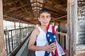 Patriotic boy in old barn Royalty Free Stock Photo
