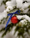 Patriotic christmas ornament on a snowy pine tree Royalty Free Stock Photography