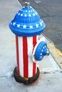 Patriotic fire hydrant a painted in the colors of the american flag in midtown manhattan Royalty Free Stock Photos