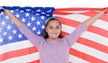 Patriotic little girl with american flag Royalty Free Stock Photo