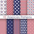 Patriotic red white and blue geometric seamless patterns vector set with american symbols Stock Images