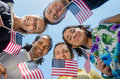 Patriotic Young Adults with Flags Stock Image