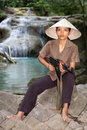 Patrol asian woman armed in nature Stock Photo