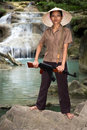 Patrol asian woman armed in nature Royalty Free Stock Images