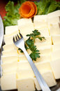 Pats of butter with fork buffet plate and carrot garnish Stock Photo
