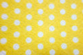 Pattern with big white polka dots on a yellow background Royalty Free Stock Photo