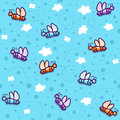Pattern colored butterflies on a blue sky background with white clouds Stock Photo