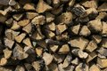 Pattern created by ends of stacked, cut firewood Royalty Free Stock Photo
