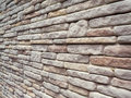 Pattern of decorative stone wall texture soft tone in inclination angle Royalty Free Stock Photo