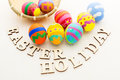 Pattern easter egg in basket with wooden text Royalty Free Stock Image