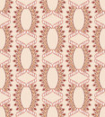 Pattern with figured ovals and diamonds in shades of brown on a beige background Royalty Free Stock Photo
