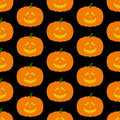 Pattern with frightful pumpkin seamless orange colored halloween evil face isolated on dark black background for holiday Royalty Free Stock Photos