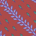 Pattern with blue leaves on red background in african style.