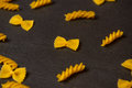 Pattern made of pasta on dark background. Royalty Free Stock Photo