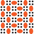 A pattern of orange ovals and black circles on white background in staggered Stock Images