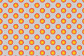 Pattern with orange spherical dots. Golden spherical polka dot pattern. Orange polka dot on white background.
