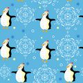 Pattern penguins and snowflakes Stock Images