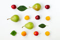 A pattern of ripe fruits and leaves - pears, plums, apricots. White background