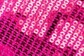 Pattern of sequins studio shot that are sewn in pink fabric Royalty Free Stock Image