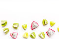 Pattern with sliced kiwi and pitaya on white background top view mockup