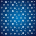 pattern of snowflakes and stars on a blue