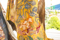 Pattern thai carve wave and tree gold on old yellow wood texture in temple Stock Photography