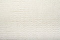 Pattern of the White Knitted Fabric Texture. Woolen background. Royalty Free Stock Photo