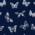Pattern with white silhouettes of butterflies on blue background. Vector.