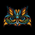Patterned colored head of the owl on black. African / indian / totem / tattoo design