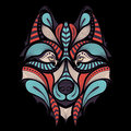 Patterned colored head of the wolf. African / indian / totem / tattoo design. It may be used for design of a t-shirt, bag