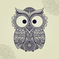Patterned owl on the ornamental mandala background. African/indian/totem/tattoo design. It may be used for design of a t