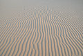 Patterned sand dunes with a wavy pattern Stock Photo