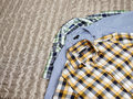 Patterned shirts men s casual on the bed Stock Photo