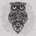 Patterned vector owl on the ornamental mandala background. African, indian, totem, tattoo design. Vector owl in tribal