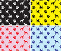 Patterns with dogs and prints of feet Royalty Free Stock Photography