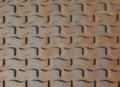 Patterns on rusty iron manhole cover background Stock Photo