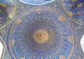 Patterns under the dome of the ancient Iranian mosque with blue color mosaic Royalty Free Stock Photo