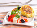 Patties of rice with pepper cheese olive salad Royalty Free Stock Photo