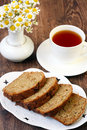Pattypan cake with raisin sliced on a plate and cup of tea Royalty Free Stock Image