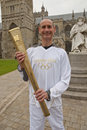 Paul Giglin, Holds the Olympic torch Royalty Free Stock Photos