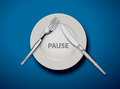Pause white empty plate with fork and knife on light blue tablecloth concept illustrator vector Royalty Free Stock Photo