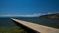 Paved gangplank over lake ohrid the leads the to a swimming spot in clear blue water macedonian hot spot Stock Photo