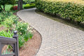 Paved pathway invites you into the garden Royalty Free Stock Image