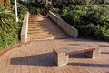 Paved Pathway and Steps with Empty Wooden Bench Royalty Free Stock Photo